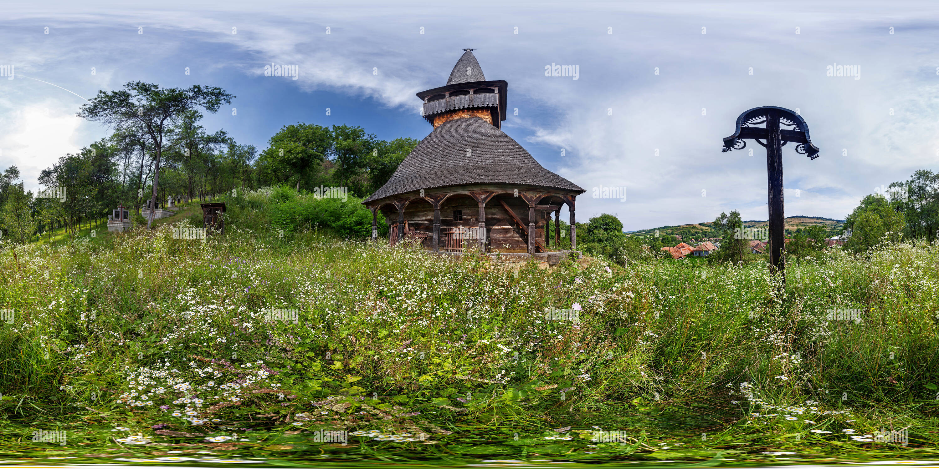 The wooden church St. Archangels Mihail and Gavril on the hill - Voivodeni - Stock Image