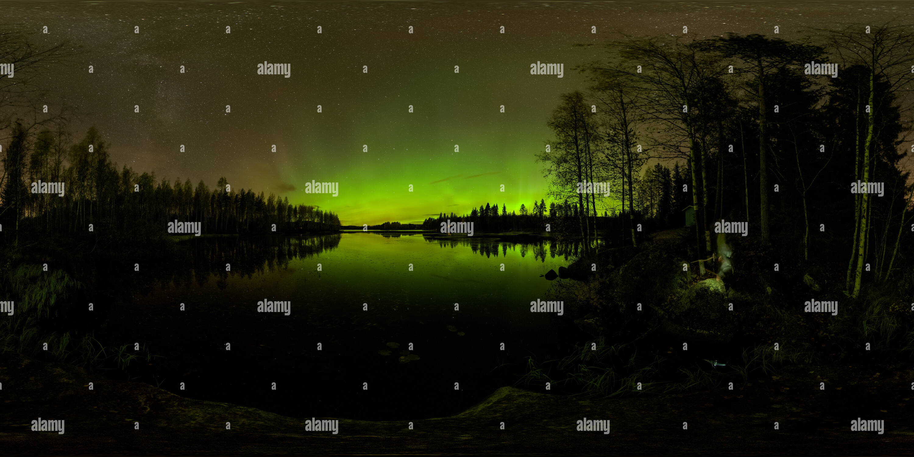 Northern lights dancing above lake Saarinen in Siilinjärvi, Finland - Stock Image