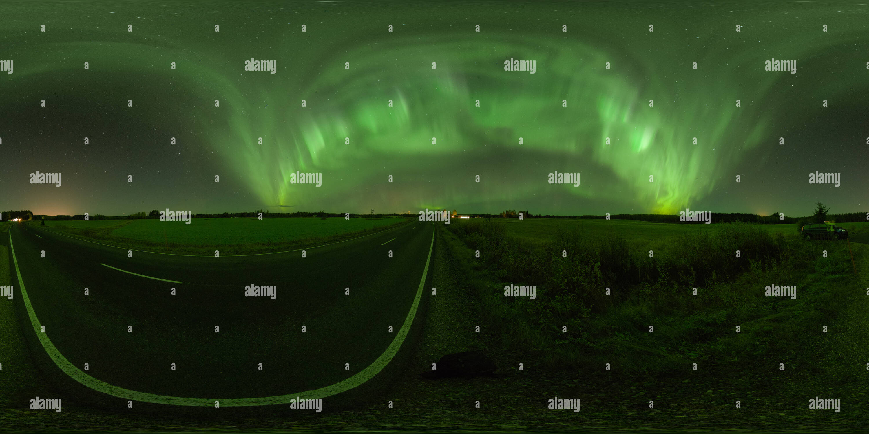 Intense green glow of northern lights on the countryside in Siilinjärvi, Finland - Stock Image