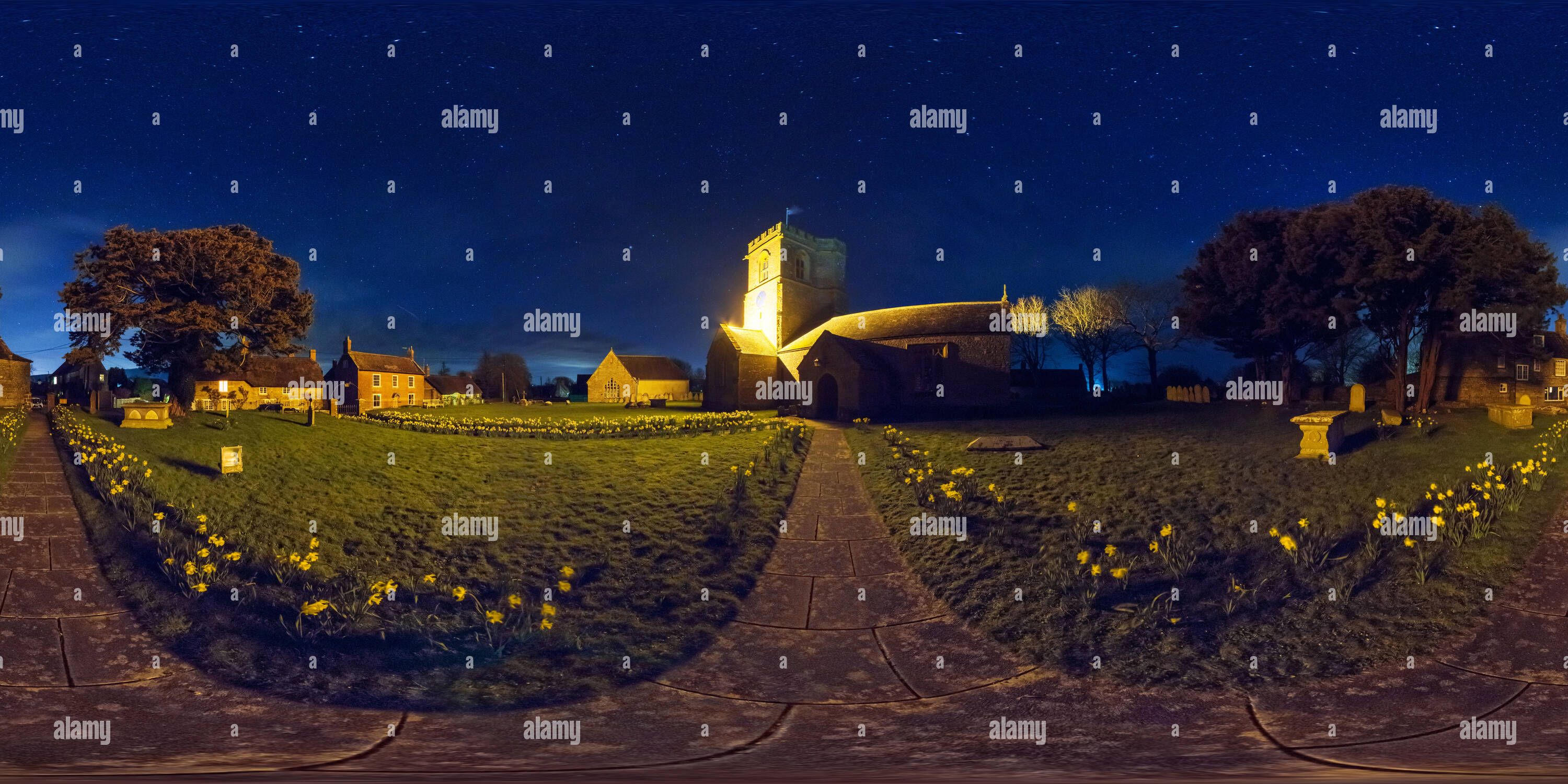 360 panorama at night on a clear sky in Burton Bradstock village church, Dorset, UK - Stock Image