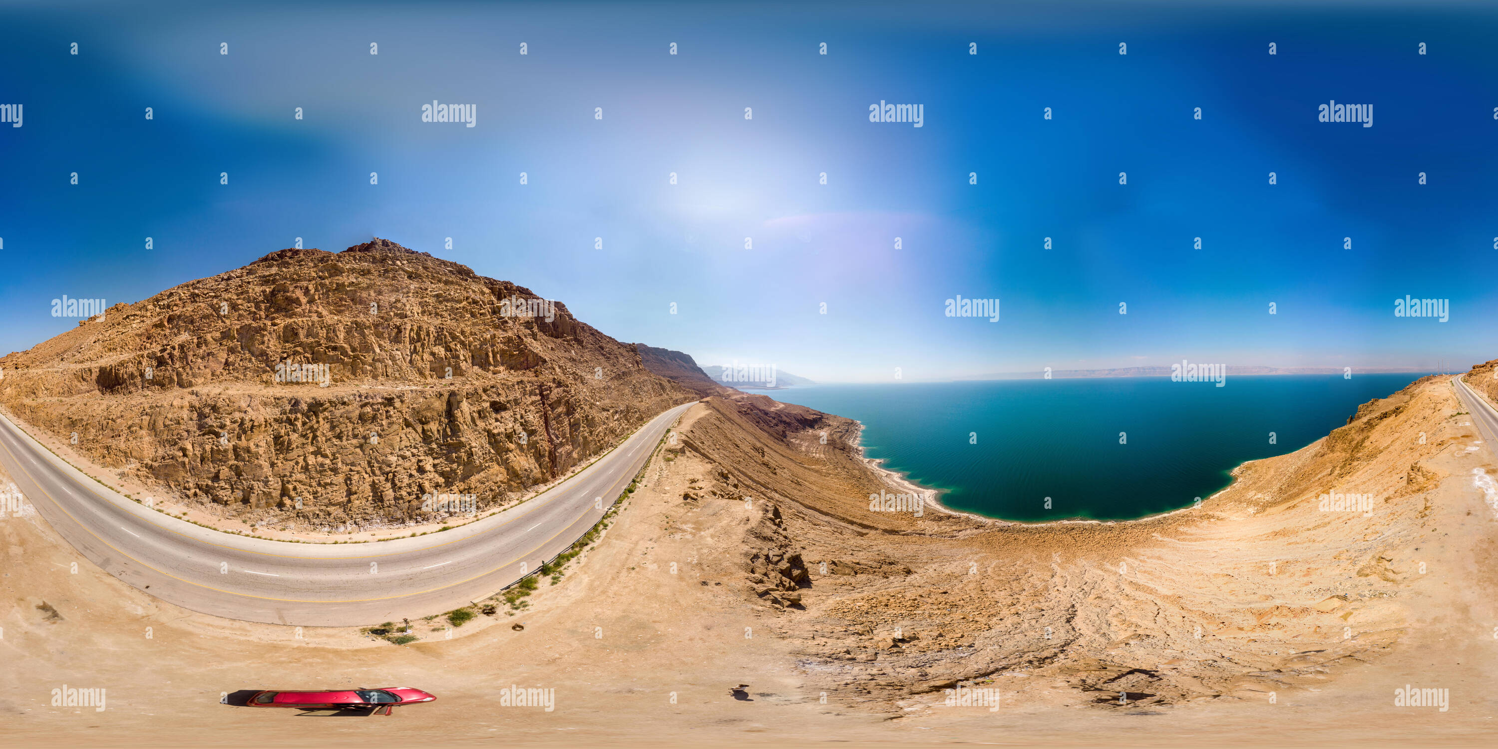 Aerial view from the main road along the Dead Sea, taken with the drone close to the rocks of the ascending mountains, 360 degree panorama image - Stock Image