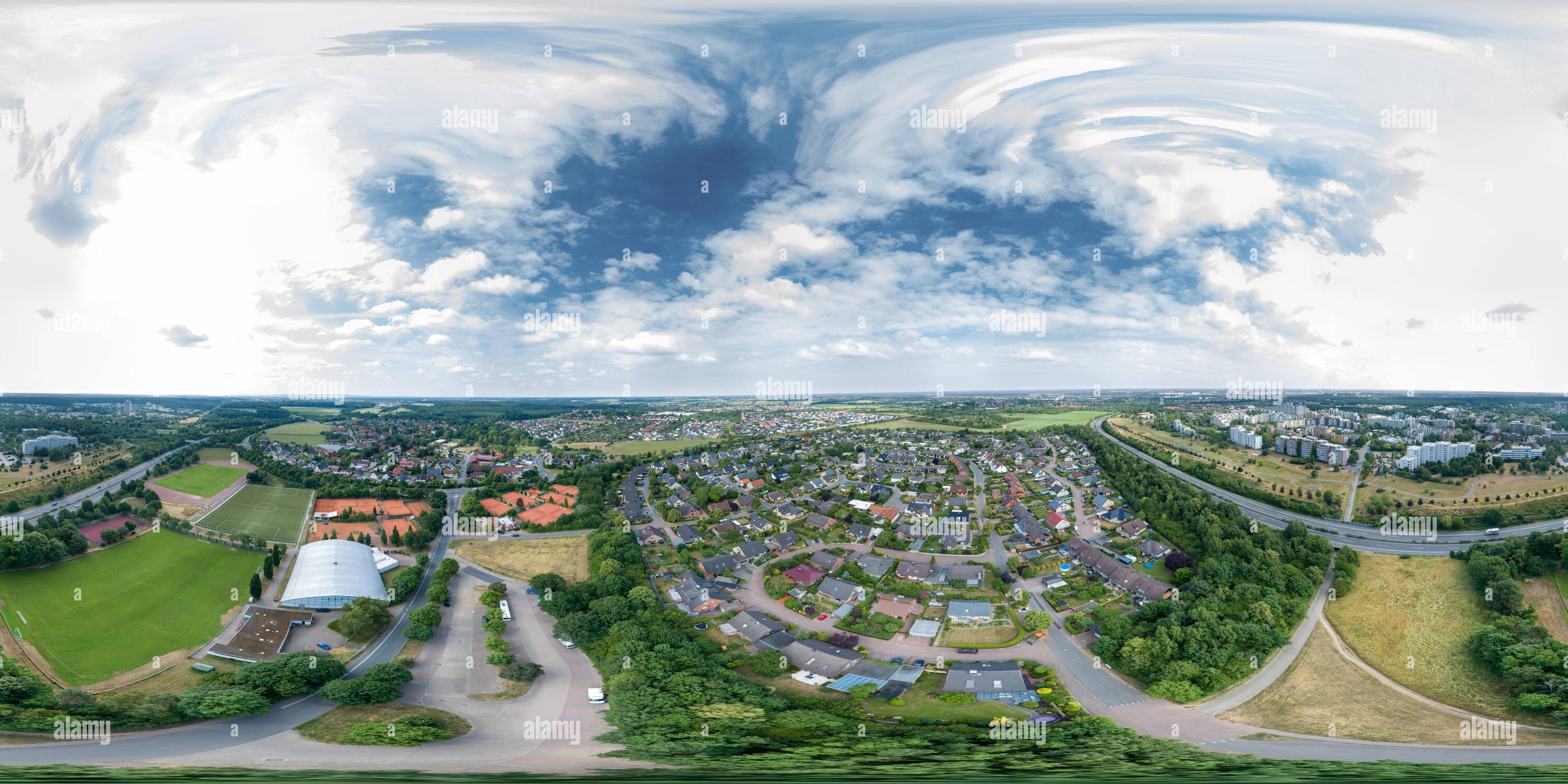 Suburb of a North German city with residential buildings and a sports facility, panoramic view from the air with the drone taken - Stock Image