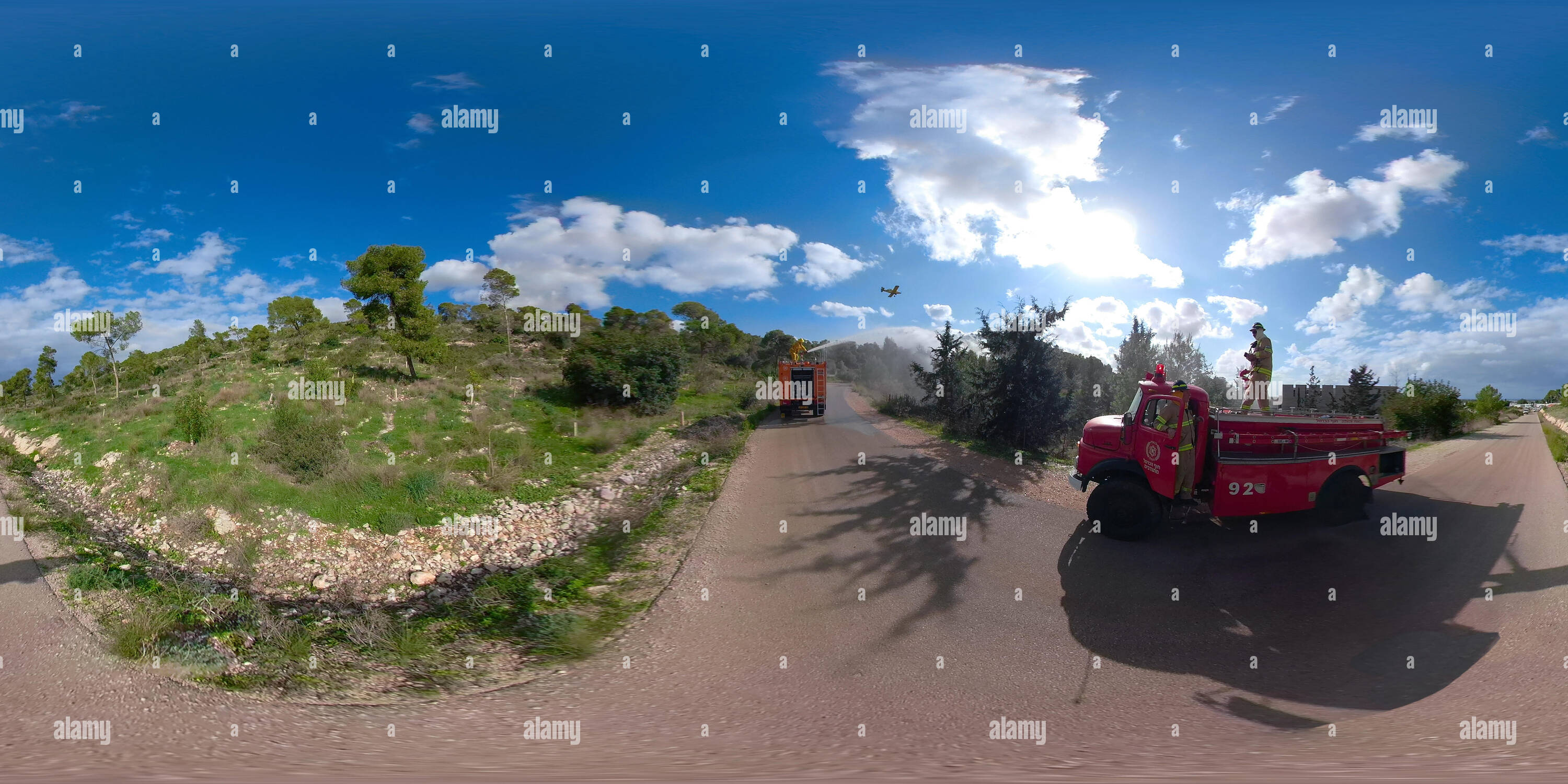 360 degree panoramic view of Firefighting airtanker drop fire retardant on burning forest during a drill. 360 degree photo VR Mt. Carmel, Israel.