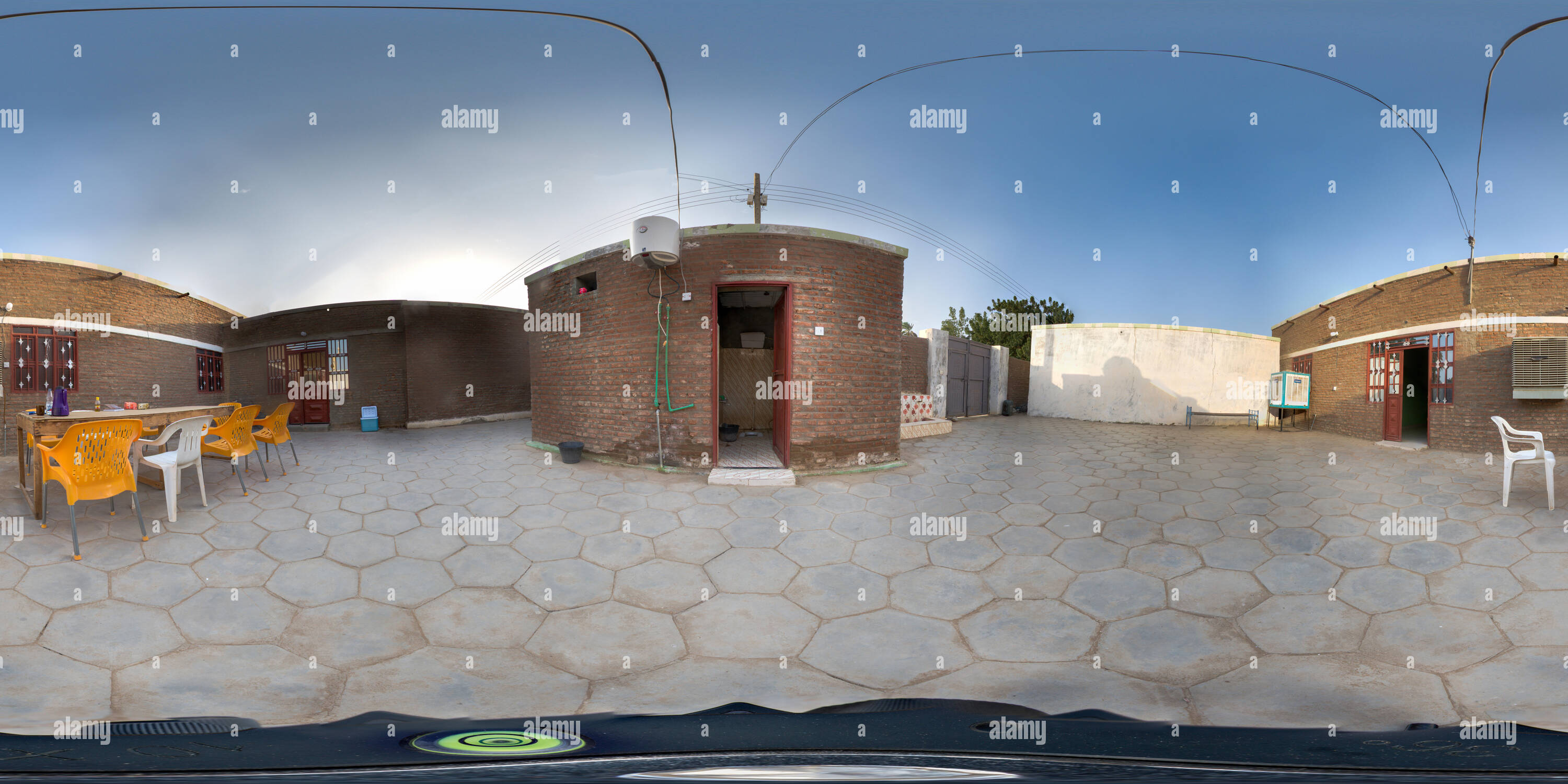 360 degree spherical panorama from the courtyard of a Nubian guesthouse in the Sudanese desert with launder and toilet house - Stock Image
