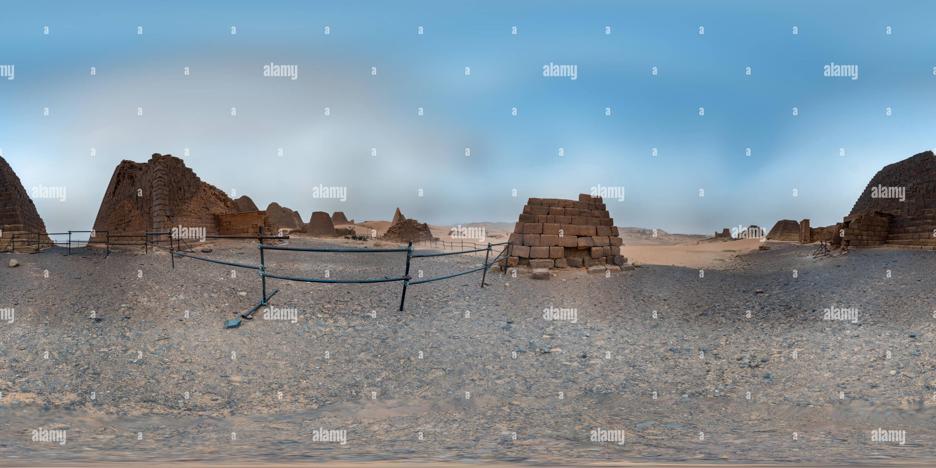 Meroe, Sudan, February 10, 2019: Three-dimensional panorama between the not completely restored ruins of the pyramids of Meroe and the fenced archaeol - Stock Image
