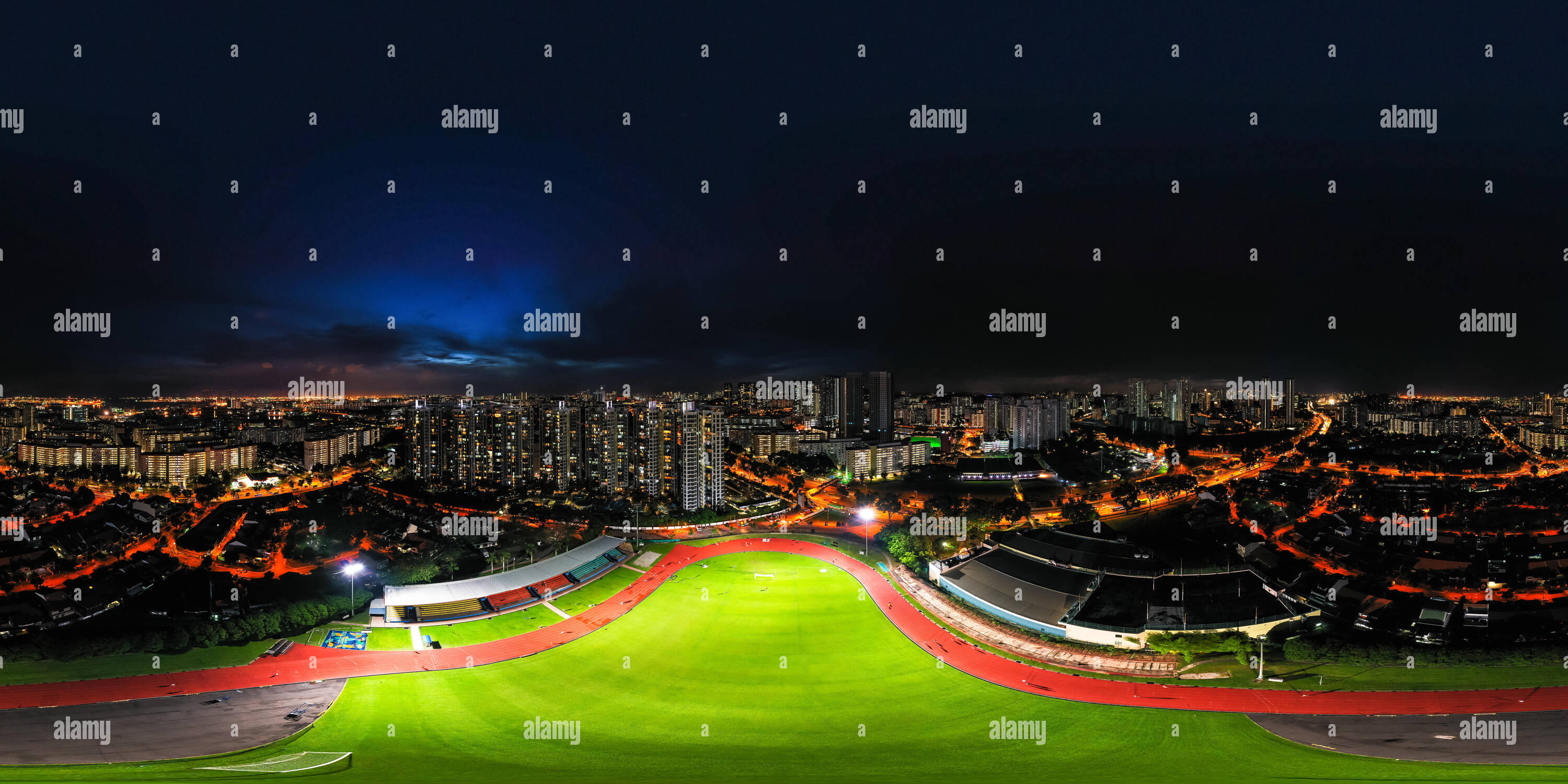 360 aerial perspective night view of a football field and running track at  Clementi Stadium, Singapore - Stock Image